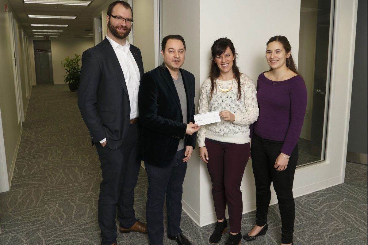 group presenting cheque to Sexual Assault Centre
